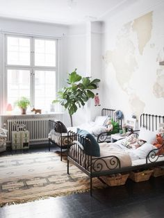 iron beds + plaster walls = divine