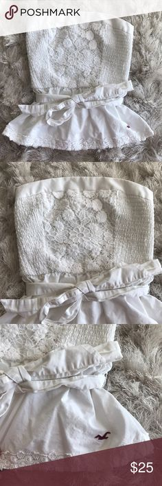 Hollister White Top In excellent condition! Barely used still perfect! Will look super cute in the summer! Hollister Tops