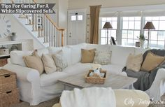 white slipcovered sofa | Real Life With A White Slipcover & Keeping It Pretty