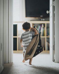 A toddler and his blankie. On a mission to take his nap! This is how he lets me know he's ready to take his nap: he grabs his blanket rubs his face on it hands it to me takes it back and then walks to his room just like this!  #kingstonatthedoorway  #135mm #candidchildhood #bicfp #clickmagazine #letthembelittle #cmg16_week18 #thelifestylecollective #follow_this_light #profile_vision #portraitpage #postthepeople #lightslove #inbeautyandchaos #illuminatechildhood #earth_portraits #dpmagfaves…