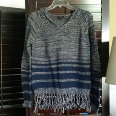 Light hooded sweater with fringe It's tan and navy blue. Cute and in good condition. EM Sweaters