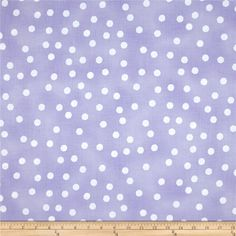 Designed by Loralie Harris for Quilting Treasures, this cotton print fabric is perfect for quilting, apparel and home decor accents. Colors include purple and white.