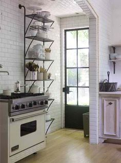 #kitchen idea - wall storage - nice if you don't mind clutter of things being out. It would be better if used on a wall away from the stove, so items don't get grease on them.