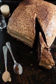chocolate cake with tiramisu liqueur and cream with milk chocolate