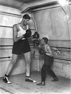 Gogea Mitu (1914-1936), the tallest professional boxer in the world. He was 7.7 ft (2.36m).
