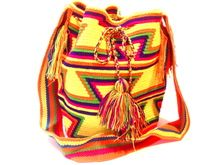 Wayúu mothers are responsible for teaching their culture and beliefs to their children, including weaving! www.susustyle.com