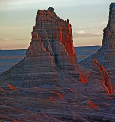 Early red shifted light gently paints this Goblin Valley butte and surrounding landscape. Goblin Valley, Rocky Mountains, Monument Valley, Utah, Families, Arizona, Scenery, Environment, Bucket