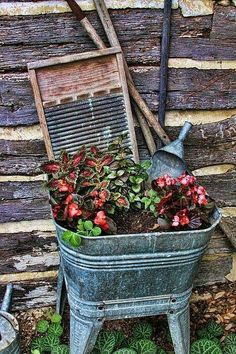 And my son wants to throw out all my old wash tubs I've collected over the years. Plant flowers in an old wash tub and add a wash board for a great outdoor display~