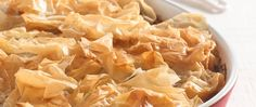 """Crunchy """"flowers"""" of prepared phyllo dough top an appealing blend of juicy chicken and vegetables flavored with tomato and garlic."""