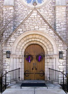 Angry door in Our Lady of Lourdes Church, in University City, Missouri - front door with Lenten wreathes