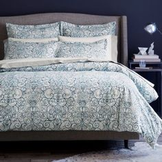 Dwell Studio Mira Bedding duvet. A modern, cobalt blue and white graphic take on a traditional damask pattern, Dwell Studio's Mira duvet cover and shams layer a line print over an abstract wash of indigo and Capri blue. A crisp white ground anchors the collection, rendered in 400-thread count cotton percale.