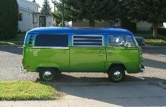 Blue green vw camper van bus.