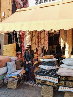 Pam Hetlinger wearing a Tara Jarmon dress at the Souk in Marrakech, Morocco