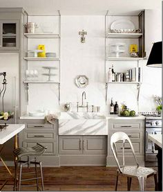 http://cotedetexas.blogspot.com/2011/09/white-marble-for-kitchen-yes-or-no.html