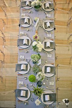 White charger plates and gray table napkins marked each place setting.   www.BridalBook.ph