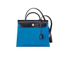 "Herbag Zip 31 Hermes bag in Officier canvas with Hunter cowhide (size PM) Measures 12"" x 10"" x 4""<br />Shoulder strap and hand strap, outside pocket<br />Palladium plated Kelly lock closure Color : Zanzibar blue/indigo blue"