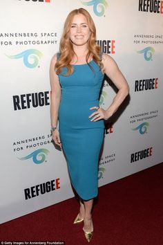 Bright spot: Amy Adams looked chic in a tight blue dress as she attended the opening of th...