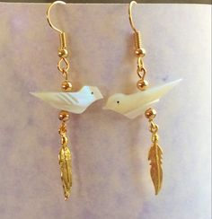 I found these Oyster shell hand carved birds at the Tucson Gem Show. They're light and airy.  I added the gold feather charms, which I also found at the Tucson show.