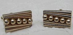 A pair of vintage cufflinks with a chunky pattern of 5 raised balls in a diagonal line Probably made in the 1960s or thereabouts These cufflinks will