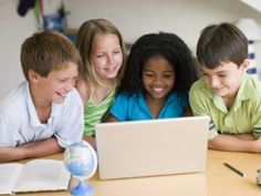 Supervised by a teacher, students engaging in social media