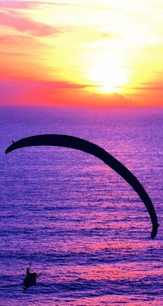 Gliding into the sunset ~ A paraglider enjoys the last minutes of daylight as the sun sets at the Torrey Pines Glider Port in San Diego, California • photo: ms4jah on Flickr