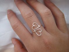 This is a wire ring that is in the shape of two hearts! It is made out of non-tarnish wire, sterling silver or 14K gold filled wire. #WireJewleryIdeas