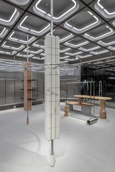 Concrete, steel and fluted glass merge inside this shop that design studio Linehouse has created for fashion brand JNBY in Xiamen, China. Commercial Design, Commercial Interiors, Display Design, Store Design, Recycled Concrete, Ceiling Materials, Concrete Ceiling, Interior Columns, Store Interiors