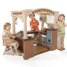 Really wish they had this when i was a kid, lol!!  The Step2 Grand Walk-in kitchen. Has 3 realistic electronic features in microwave, stovetop and phone. Custom appliances feature a pretend grill and electronic stovetop. Realistic oak hardwood foam flooring provides a touch of realism. Spacious countertop with stainless steel appliances. Includes 103 accessory set, 62 piece food set and 11 inch stool.