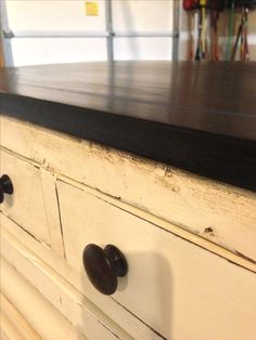 Shabby chic dresser; cream chalk paint with stained top and knobs.