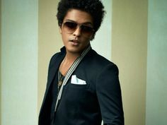 Bruno Mars revealed why he changed his Latino last name in the April issue of GQ magazine.