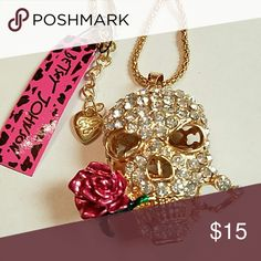 Beautiful multi-colored Crystal skull necklace Betsey Johnson Crystal Skull with pink rose necklace chain is 28 inches long. Extremely unique fashion jewelry Betsey Johnson Jewelry Necklaces