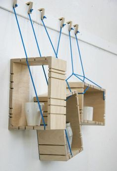 Parasite shelf by Johanna Landin - The system consists of plywood boxes suspended from wooden hooks on blue ropes, which pass through grooves in the outside of each box. Inspire Me Home Decor, Deco Design, Wood Design, Wood Furniture, Furniture Design, Muebles Art Deco, Plywood Boxes, Regal Design, Shelving Systems