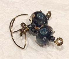 ValVaanaLampwork Handmade Glass Lampwork Beads Earrings Wire Wrap Antique Brass Glass Black Doughnuts with Silvery Roses by ValVaaniaLampwork on Etsy https://www.etsy.com/listing/233225245/valvaanalampwork-handmade-glass-lampwork
