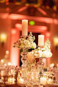 Glam centerpieces with tall candlesticks decorated with hydrangeas and roses {Thompson Photography Group}