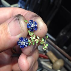 tarratt_fine_jewellers Under construction a section of a bespoke brooch... Heart shape sapphires are used to create the flower petals with green enamel leaves... #handmade #brooch