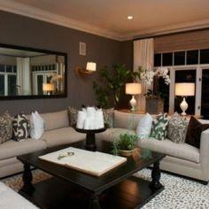 Beige couch:  cream/grey pattern rug, dark coffee table, white/chocolate accent, darker grey wall paint