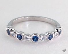 SKU 49490 - Take the mystic appeal of marquise shape sapphires and couple it with round brilliant diamonds and milgrain details and you are sure to cause a sensation with this ring.