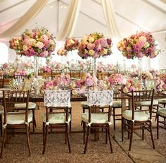 Love all the flowers in this gorgeous, pastel tent reception!