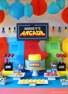 This ABSOLUTELY adorable ARCADE {VIDEO GAME} THEMED BIRTHDAY PARTY was submitted by Sarah Epstein of Crackers Art! What a fabulous birthday party theme that any child would adore! There are so many incredible ideas here! Some of my favorite party elements are: The arcade stand up backdrop The Pac Man cookies The joy stick cake pops The Sonic golden ring doughnuts The Mario mushroom muffins The Pac Man cake And much MORE!