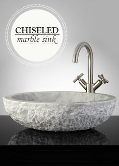 This Hand-Carved Marble Vessel Sink with a stunning chiseled exterior adds a touch of nature to your bathroom design.
