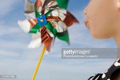 Child blowing pinwheel