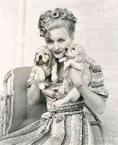 Joan Bennett with cocker spaniel puppies