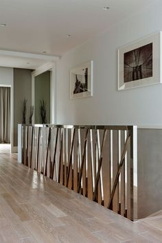 Warsaw Apartment Hardwood Flooring Flanked By Metal Beams White Walls And White Ceiling: Minimalist Warsaw Duplex Exhibiting a Powerful Character