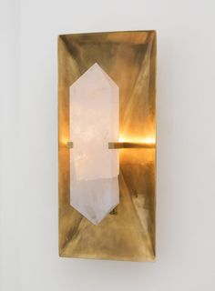 KELLY WEARSTLER | HALCYON RECTANGLE SCONCE. Hand selected natural quartz stone set in a sculptural brass base.