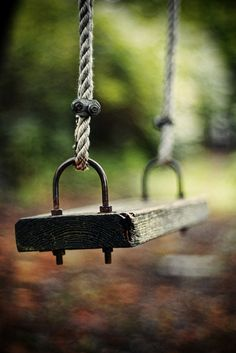 Lazy summer days.......reminds me of my dad pushing me on a swing like this he made in hung in a large oak tree at home.
