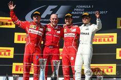 Podium: race winner Sebastian Vettel, Ferrari, second place Kimi Raikkonen, Ferrari, third place Valtteri Bottas, Mercedes AMG F1, Jock Clear, Ferrari Chief Engineer