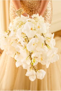 Stunning Phalaenopsis orchid bouquet | Photo by Mike Larson | Floral design by Panacea Event Floral Design #orchid #white #bouquet