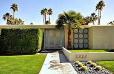 """Mid-Century Modern House by Chimay Bleue, via Flickr"" check out the symetry of this place, right down to the cactus. I wonder if the plate-like wall element is backlit at night? I find its sublime order very restful to look at."