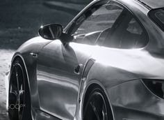 Shining car in a dark street - A sports car illuminated by the setting sun in a narrow dark street Car Ins, Sunset, Dark, Sports, Grey, Collection, Hs Sports, Gray, Sunsets