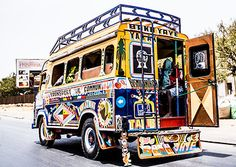 """Matthew Short Photography """"The Ndiaga Ndiaye"""" is the number one transportation in Senegal. No seatbelts, no windows, full of colors, hop in and enjoy the ride!  Prints available in various sizes at www.matthewshortphotography.com"""